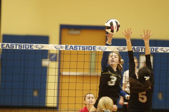 Eastside's Andersen Wade (3) taps the ball over the net during the Eagles' win over South Pointe Tuesday night in the the second round of the Class AAAA volleyball playoffs.