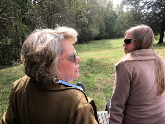 Susan Hughes, left, and her daughter, Rebecca Holmes, take a ride through their family's historic farm.