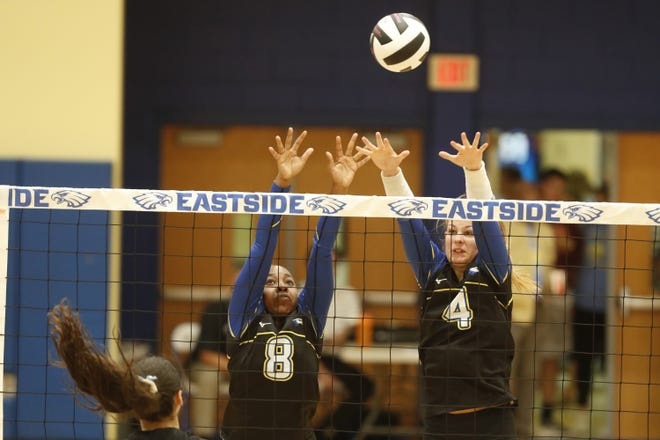 Eastside's  Kaity Freeman (8)  and Tabitha Wheeler (4)  go up for a block during the Eagles' win over South Pointe Tuesday night in the second round of the Class AAAA volleyball playoffs.