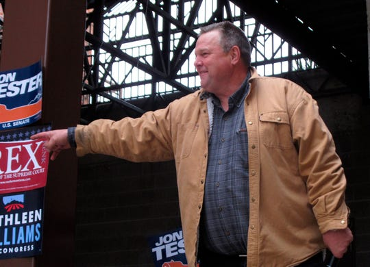 U.S. Sen. Jon Tester, D-Mont., leads a crowd in a cheer during a rally in Helena, Mont., on Oct. 31.