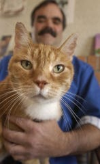 -  Eddie the cat was rescued from a meth lab and nursed back to health by Dr. Tim Gilligan and the staff of the Animal Medical Clinic in Great Falls in 2003.