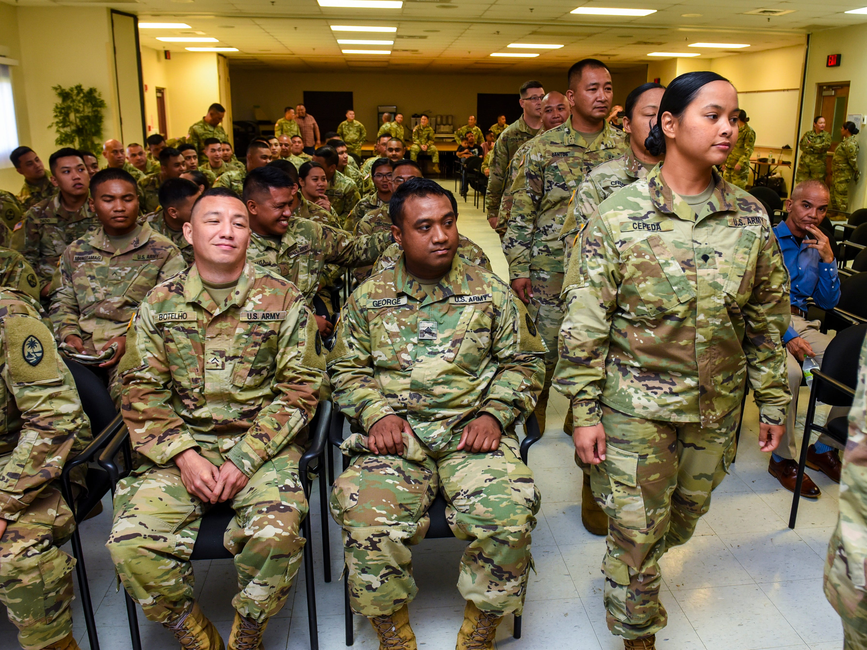Guam Army National Guard soldiers are recognized during a sendoff ceremony at the Guard's Readiness Center in Barrigada on Wednesday, Oct. 31, 2018. The soldiers are slated to be deployed, to aid in the recovery efforts on the island of Saipan, in the wake of the destruction abd aftermath left by the onslaught of Super Typhoon Yutu.