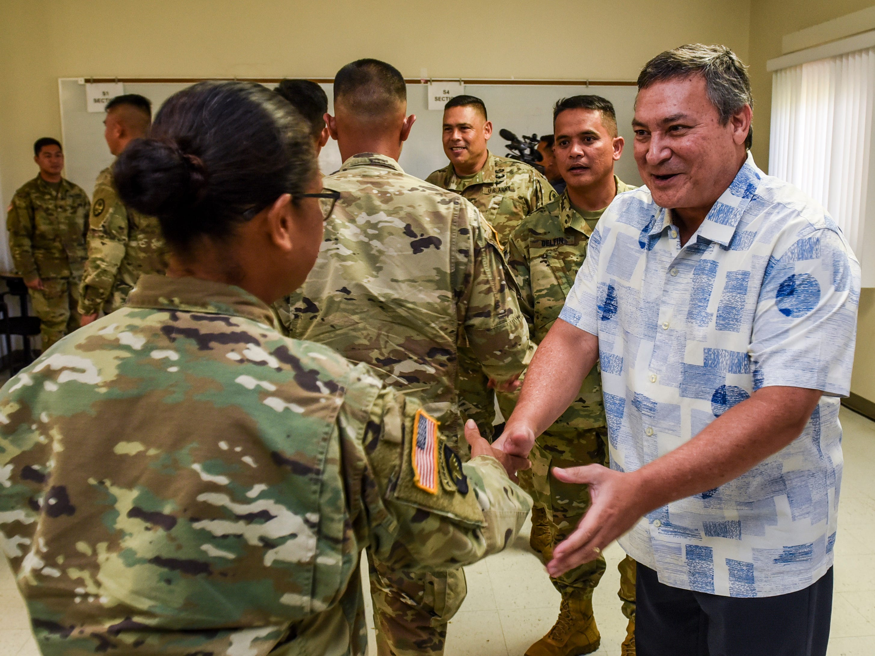 Gov. Eddie Calvo shakes hands with Guam Army National Guard soldiers during a sendoff ceremony at the Guard's Readiness Center in Barrigada on Wednesday, Oct. 31, 2018. The soldiers are slated to be deployed to aid in the recovery efforts of the island of Saipan in the Commonwealth of the Northern Mariana Islands, in the aftermath of Super Typhoon Yutu.