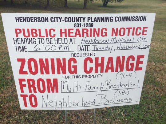 This sign, in front of the proposed site, advertises the public hearing on the requested zoning change. The meeting is set for Tuesday evening at 6 p.m. at the Henderson Municipal Center
