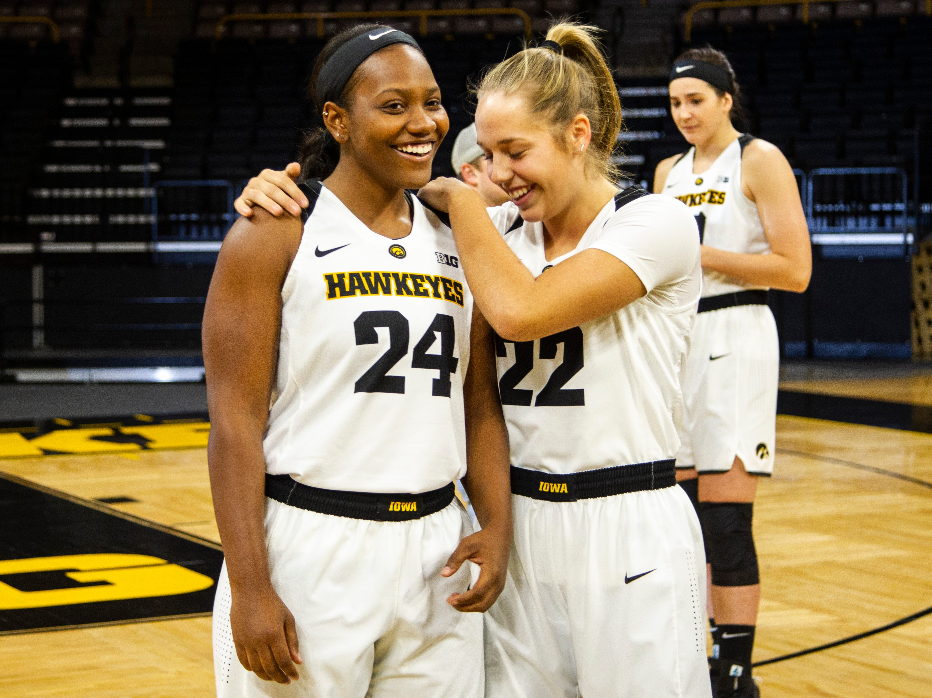 Iowa guard Zion Sanders (24) and Kathleen Doyle (22) joke around during Hawkeye women's basketball media day on Wednesday, Oct. 31, 2018, at Carver-Hawkeye Arena in Iowa City.