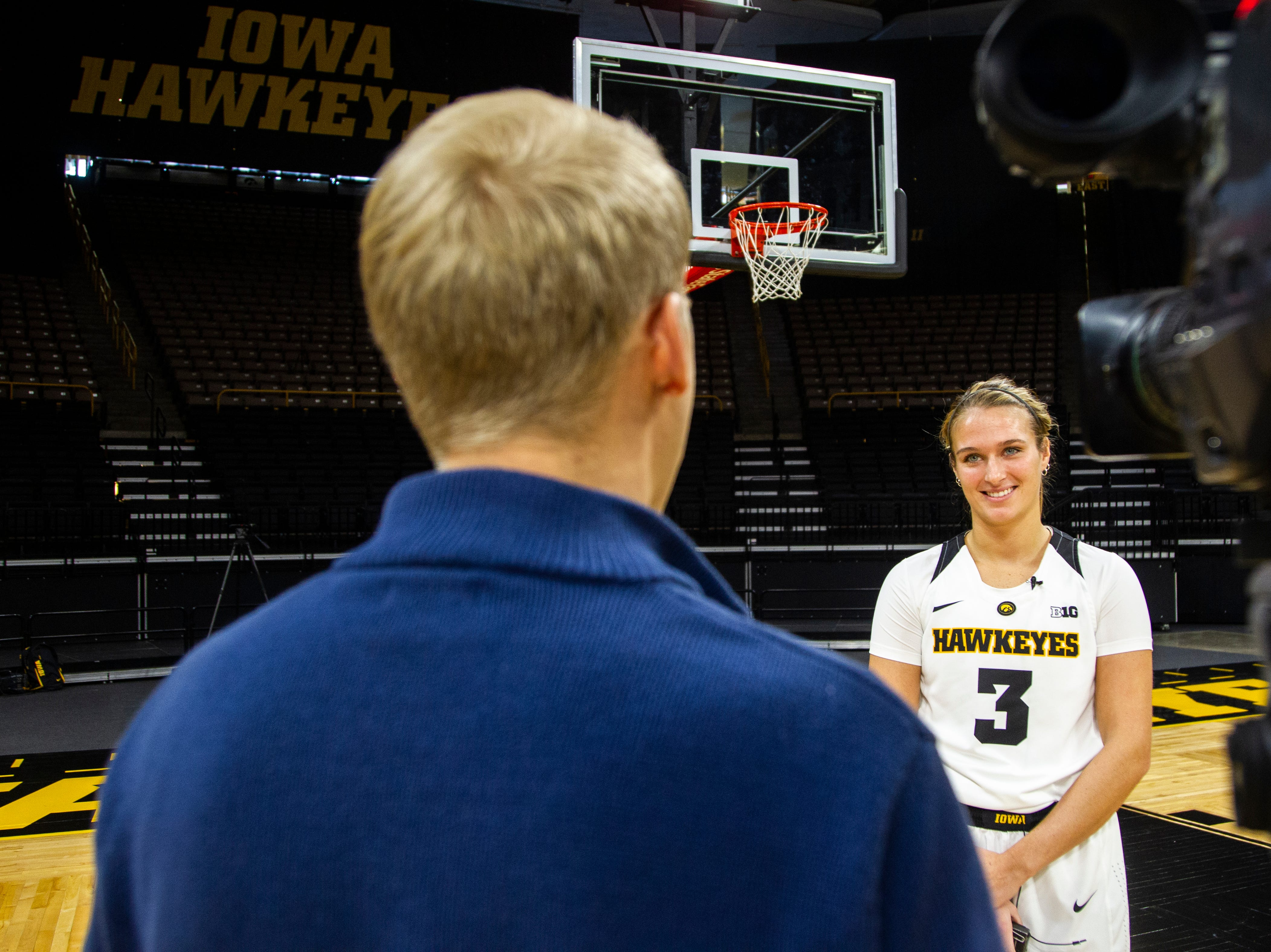 Iowa guard Makenzie Meyer (3) speaks with a reporter during Hawkeye women's basketball media day on Wednesday, Oct. 31, 2018, at Carver-Hawkeye Arena in Iowa City.