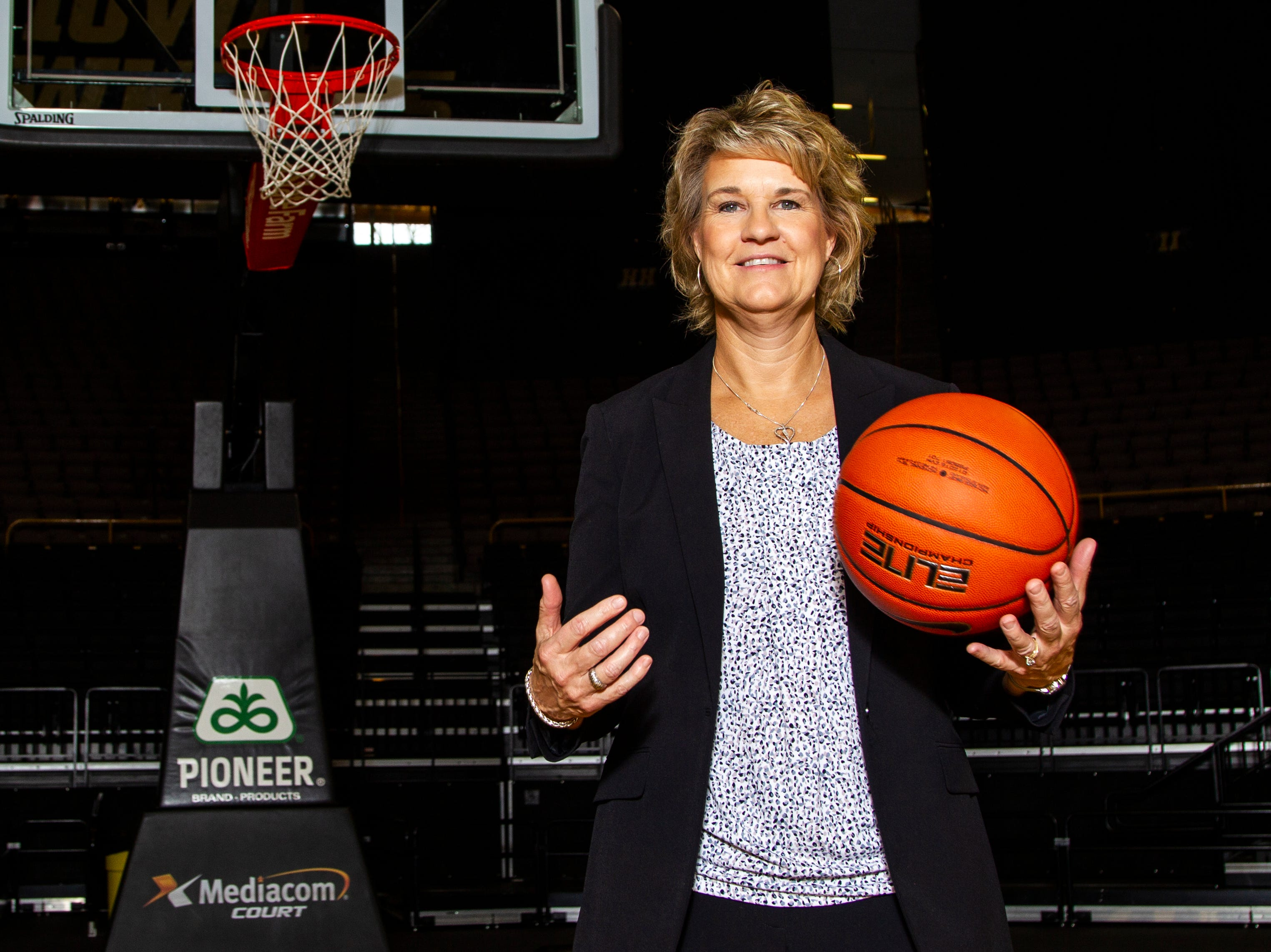 Iowa head coach Lisa Bluder poses for a portrait during Hawkeye women's basketball media day on Wednesday, Oct. 31, 2018, at Carver-Hawkeye Arena in Iowa City.