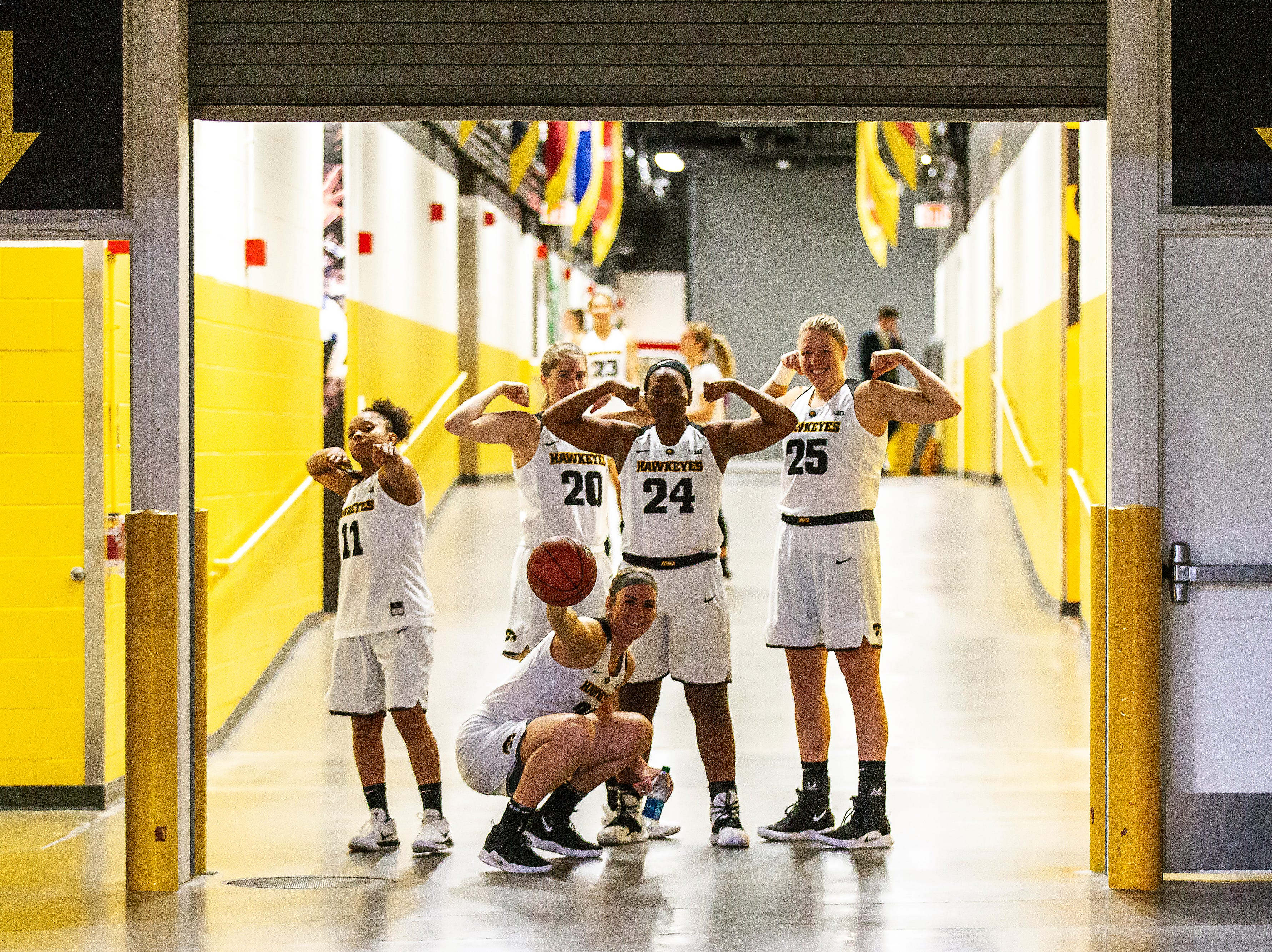 Iowa's Tania Davis (11) Kate Martin (20) Zion Sanders (24) Monika Czinano (25) and Hannah Stewart (21) pose for a photo in the tunnel during Hawkeye women's basketball media day on Wednesday, Oct. 31, 2018, at Carver-Hawkeye Arena in Iowa City.