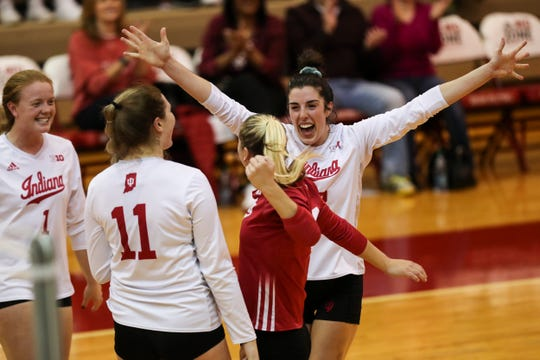 IU volleyball players celebrate during a recent match.  The Hoosiers were 14-9 on the season entering play Wednesday.