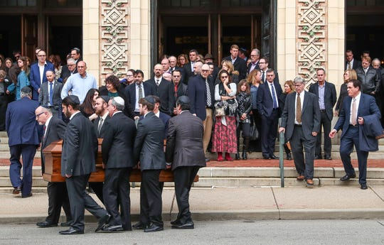 The caskets of brothers David and Cecil Rosenthal are carried out of Rodef Shalom Synagogue in Pittsburgh on Tuesday, Oct. 30, 2018.