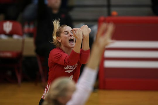 Sophomore libero Bayli Lebo celebrates during an IU volleyball match earlier this season. The Hoosiers have already won five Big Ten matches this season, after going just 1-19 last year.