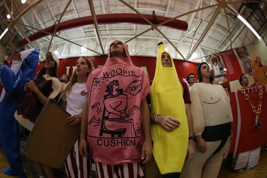 Students are encouraged to dress in costume for home IU volleyball matches, and occupy one end of the University Gym stands, coordinating cheers during matches.