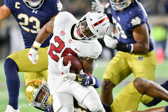 Notre Dame's Julian Okwara takes down Stanford Cardinal running back Bryce Love (20) in their game this season at Notre Dame Stadium.