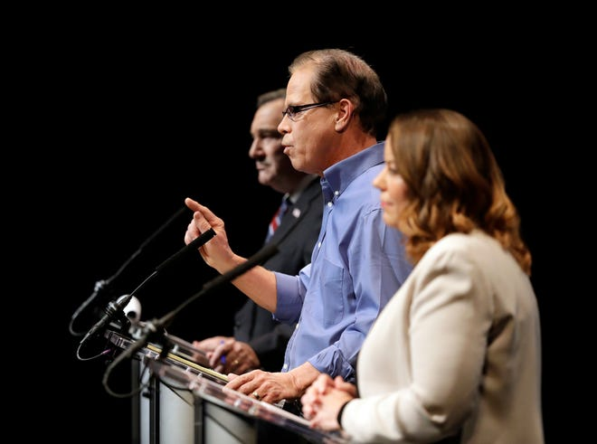 Republican former state Rep. Mike Braun, middle, speaks during a U.S. Senate Debate against Democratic Sen. Joe Donnelly and Libertarian Lucy Brenton, Tuesday, Oct. 30, 2018, in Indianapolis.