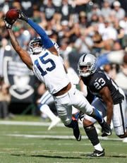 Indianapolis Colts wide receiver Dontrelle Inman (15) caught a pass in front of Oakland Raiders cornerback Nick Nelson (23) during their game Sunday in Oakland, Calif.