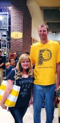 Amanda Loyd snagged a photo with her favorite Pacers player Rik Smits when he came back to a game in 2014.