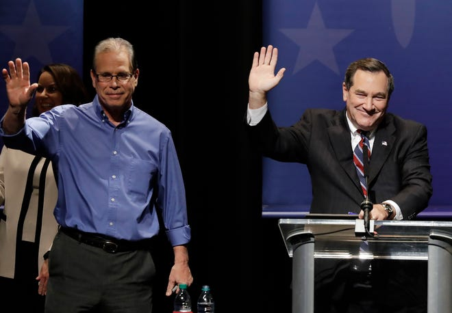Republican Mike Braun (left) and Democratic Sen. Joe Donnelly wrap up the U.S. Senate debate Tuesday in Indianapolis.