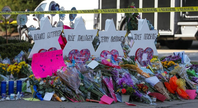 Flowers, notes and candles surround memorials Oct. 30, 2018, for each of the 11 shooting victims at the Tree of Life Synagogue in Pittsburgh, Pennsylvania