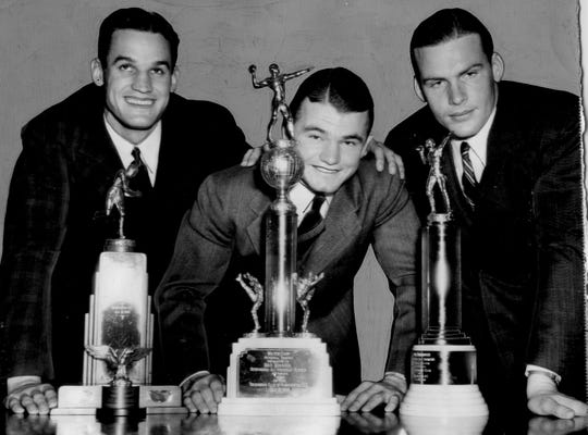 Jan. 17, 1940 - Ken Kavanaugh (LSU) with the Rockne Award, Kinnick (Iowa) with the Walter Camp Award and John Kimbrough (Texas A&M) with a Special Award in Washington D.C. at the Touchdown Club.