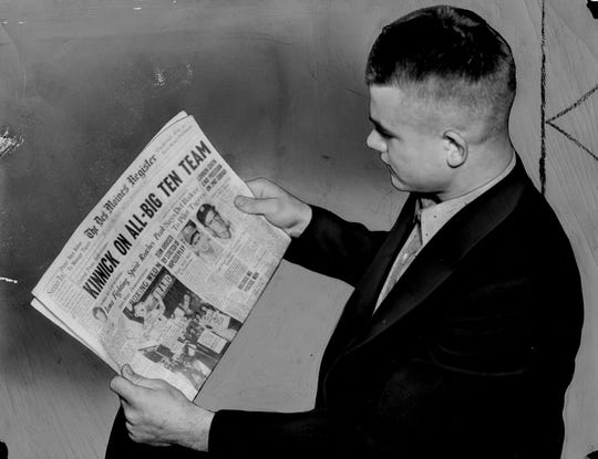 Nov. 20, 1937 - Nile Kinnick reads the Register on a stop in Des Moines. The story of the day was Kinnick being selected all-Big Ten halfback. Iowa was on its way to Lincoln, Neb., for a game with the University of Nebraska.