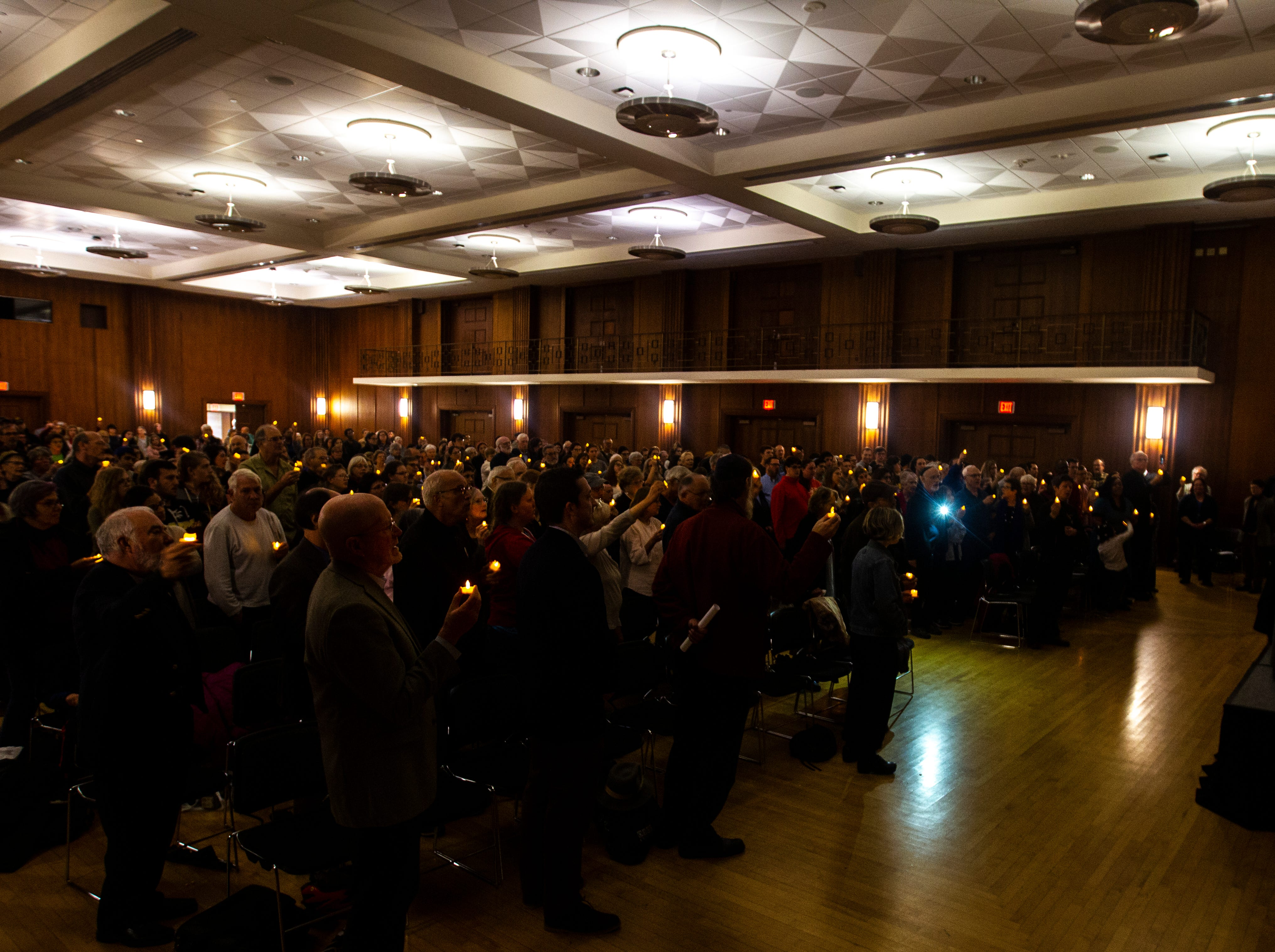 Community members hold candles during a vigil on Tuesday, Oct. 30, 2018, in the Iowa Memorial Union second floor ballroom on Tuesday night, Oct. 30, 2018. The vigil was in response to the Pittsburgh synagogue and Louisville shootings.