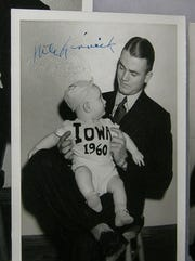 Late University of Iowa football star Nile Kinnick (1918-1943) is pictured in 1939 holding future UI student Sanders Hook, who was born that year. Hook's shirt says 1960, which is the year he graduated from UI. This picture will be part of the Hawkeye Collector's Showcase.