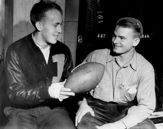 Nov. 12, 1939 - Holding the ball that sailed over the crossbar for the deciding extra point in a 7-6 win over Notre Dame are Iowa's captain Erwin Prasse, left end, and Nile Kinnick.