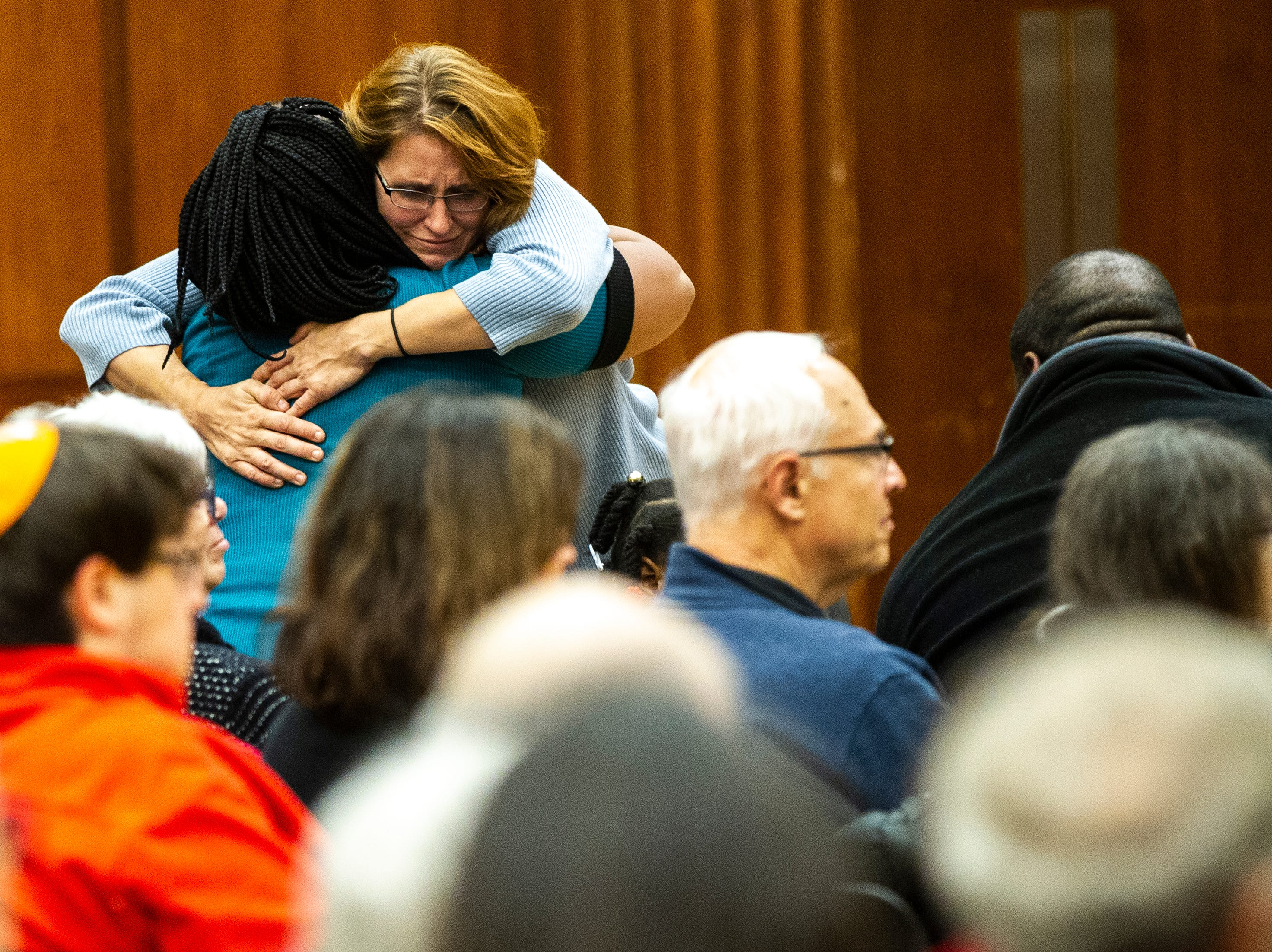 Rachael Hills, of Iowa City embraces Gerri Allen after her speech during a vigil on Tuesday, Oct. 30, 2018, in the Iowa Memorial Union second floor ballroom on Tuesday night, Oct. 30, 2018. The vigil was in response to the Pittsburgh synagogue and Louisville shootings.