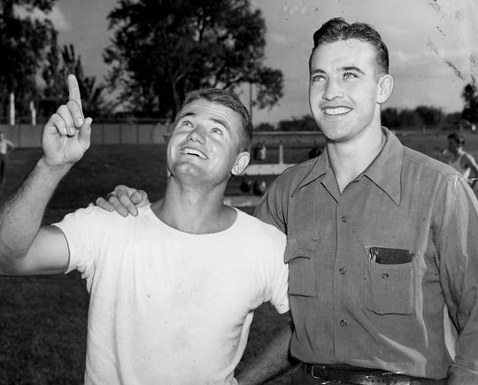 Sept. 18, 1941 - Two former Iowa teammates who will soon be buddies in the sky are pictured above. Iowa's famous all-American Nile Kinnick who is coaching under Dr. Eddie Anderson and marking time until he's called to the naval air corps at Pensacola, Fla., in the fall and Jerry Niles, Davenport, one-time back and center on the Hawk teams before Anderson came to Iowa. Niles has been attending Michigan State and will enter the naval air corps soon.
