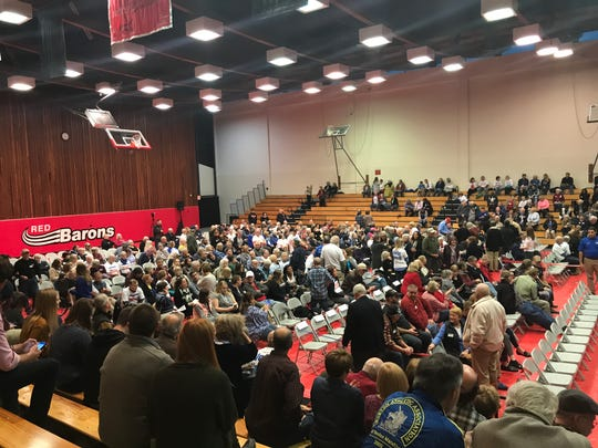 The crowd settles into the Corning Community College gymnasium Tuesday evening to watch the debate between Rep. Tom Reed and challenger Tracy Mitrano.