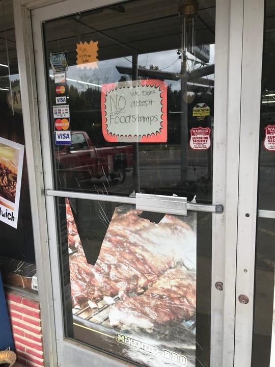 The glass of the front door of McKenzie's Market has been broken in a previous break-in.