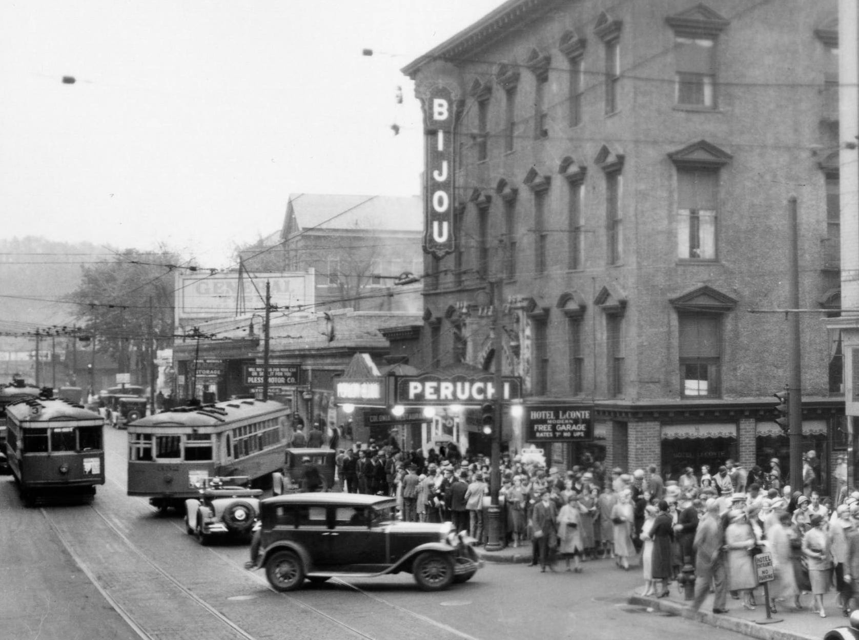 Gay Street looking south in 1932 showing a crowd in front of Bijou Theatre. Also shown are Pless Motor Co., Hotel LeConte, Cumberland Hotel, and East Tennessee Music Co.