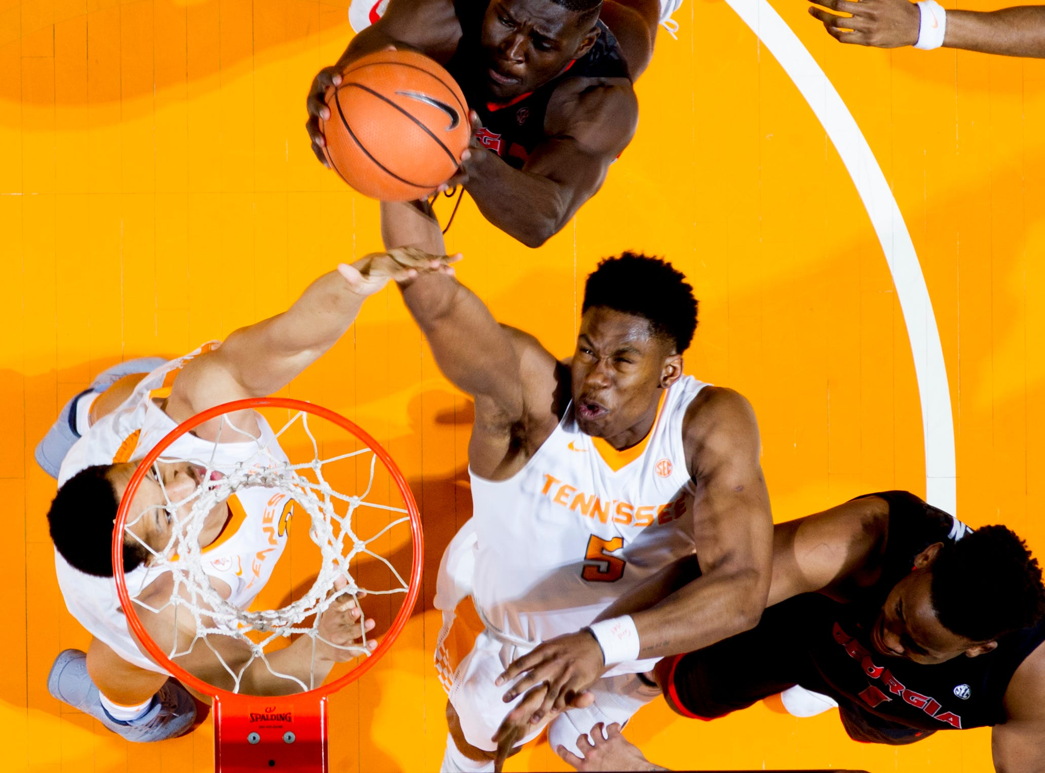 Tennessee forward Admiral Schofield (5) reaches for the rebound during a game between Tennessee and Georgia at Thompson-Boling Arena in Knoxville, Tennessee on Saturday, March 3, 2018.
