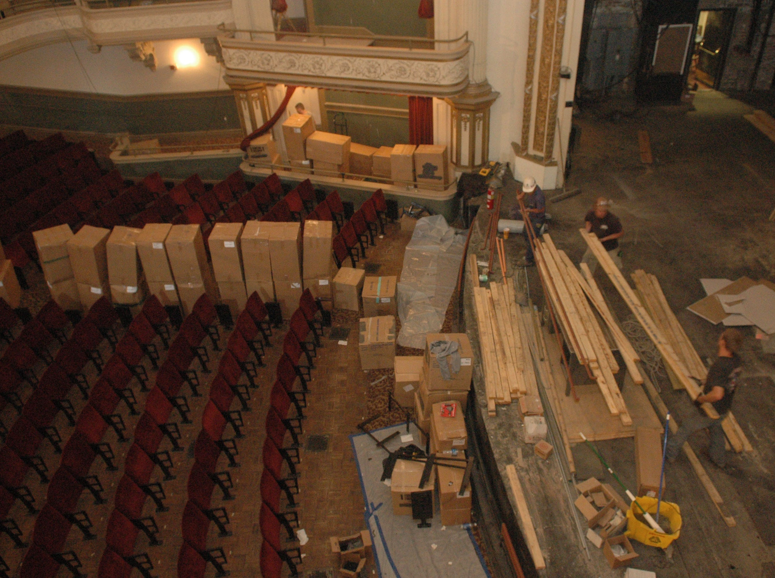 Boxes of refurbished seats fill the isles  and carpenters and lumber perform on the stage at the Bijou Theatre Wednesday morning on  April 26, 2006.