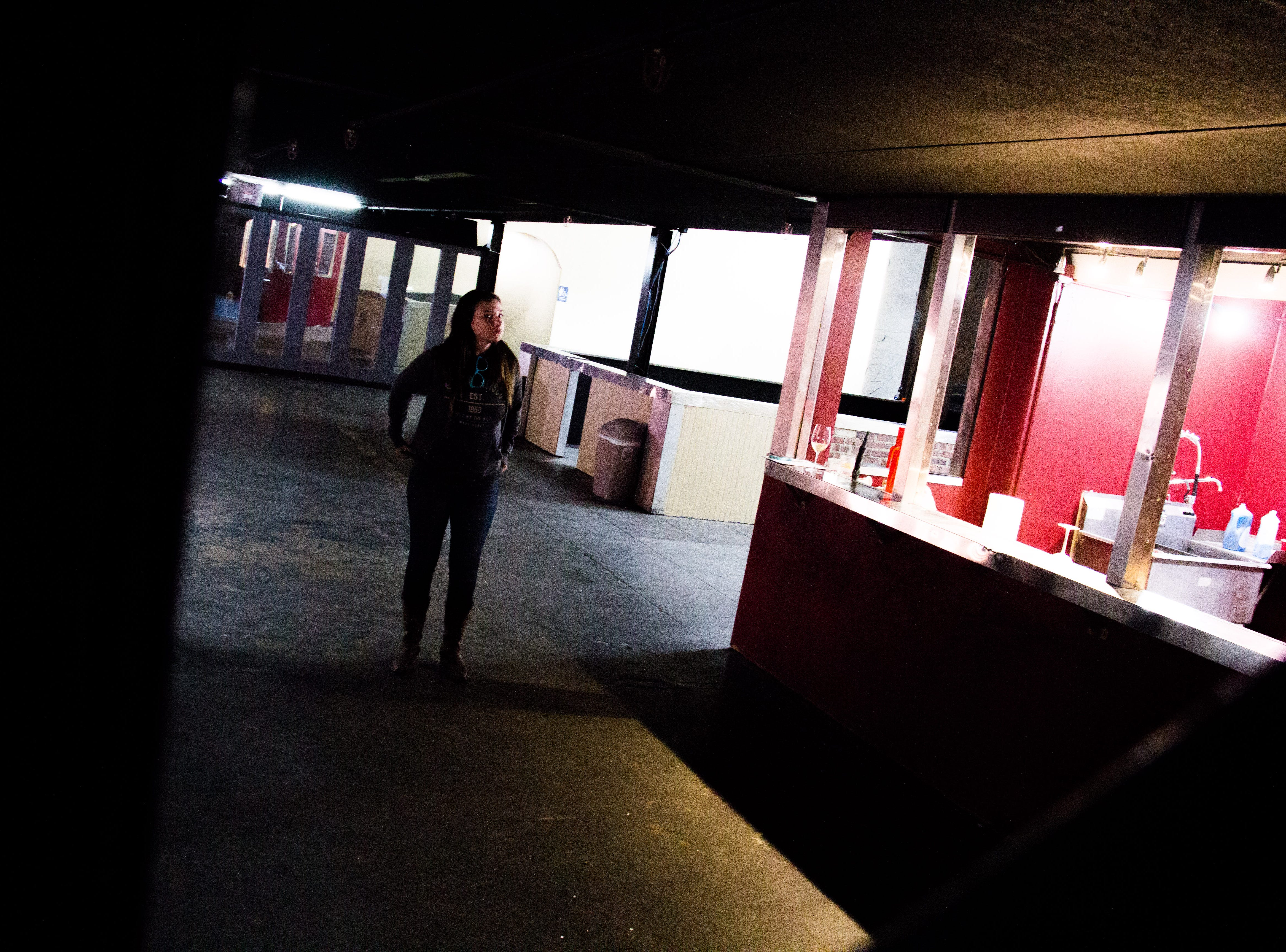 Katie Galyon, owner of the Winery at The International, stands near the venue's bar on Oct. 31, 2018. The bar will be split between a full-service bar and a tasting bar.