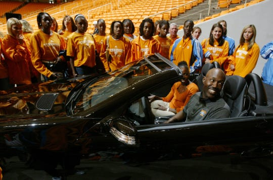 Lady Vol track coach J.J. Clark had lots to smile about after being awarded a  new Mercedes  car for coaching the team to an  NCAA indoor national championship title this season. The track team and the women's basketball team were honored  on Saturday at Thompson-Boling Arena on April 23, 2005