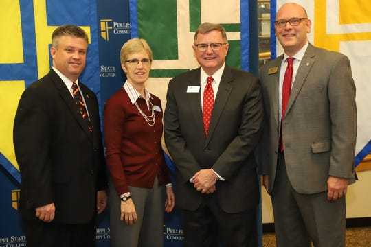 Pellissippi State Community College President Anthony Wise, Pellissippi State Interim Vice President of Academic Affairs Kathy Byrd, King University President Alexander Whitaker and King University Vice President for Academic Affairs Matt Roberts stand together after signing a dial admission agreement between the two schools.