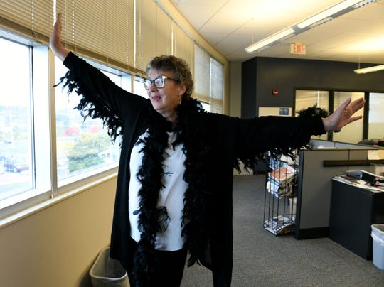 Mary Constantine shows off a last minute Halloween costume in the office Wednesday, October 31, 2018.