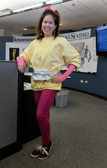 Hayley Choy shows off a last minute Halloween costume in the office Wednesday, October 31, 2018.