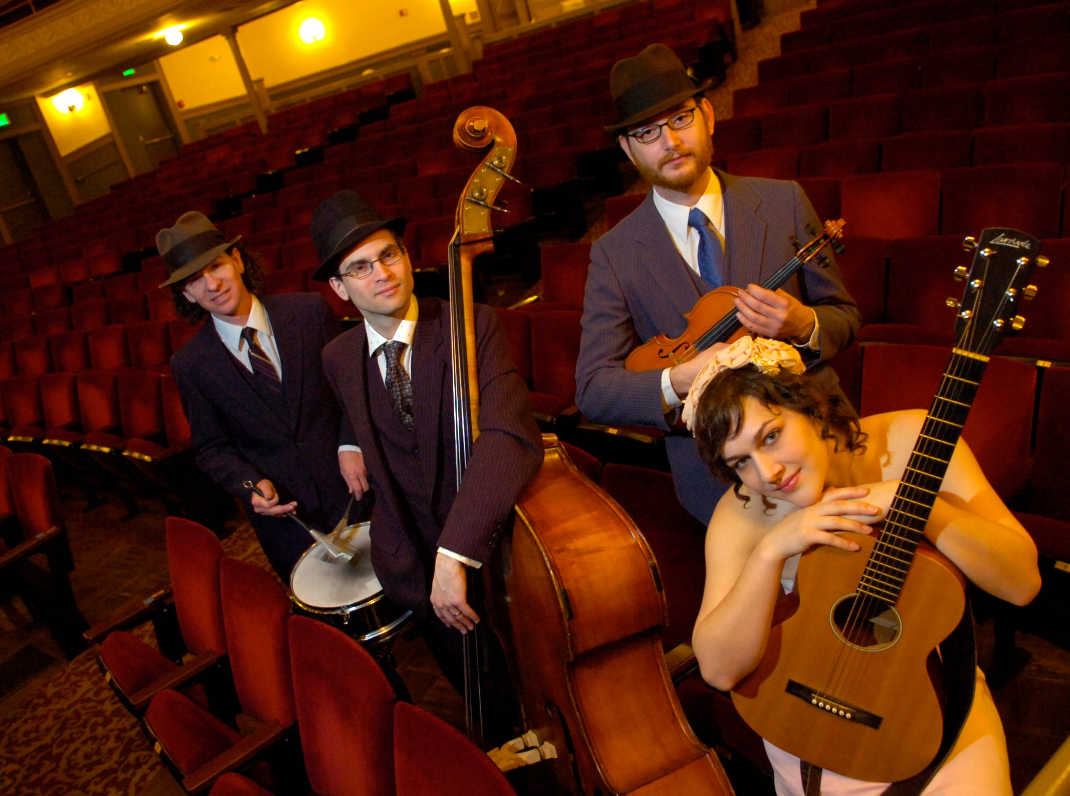Christabel and the Jons, shown here Thursday at the Bijou Theatre, are one of Knoxville's up and coming acts combining the sound of folk music with 1920s and '30s jazz and pop with a little 1940s gypsy jazz and country. Pictured from left are Jon Whitlock (cq), Mischa Goldman, Seth Hopper and Christa DeCicco. Photo taken on 2/1/2007.