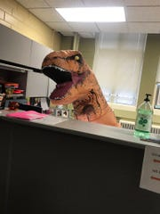 Ashly Pearson, senior IT technologist in the UT Knoxville department of nuclear engineering, dressed up as a dinosaur on Halloween.