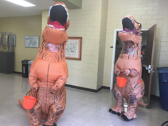 Ashly Pearson, a senior IT technologist in the UT department of nuclear engineering, and Amanda Lovelace, an adviser in the department of nuclear engineering, dressed up as dinosaurs on Halloween.