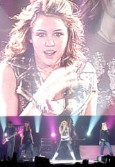 "Miley Cyrus performs at Thompson-Boling Arena as part of the ""Best of Both Worlds"" tour in 2007."