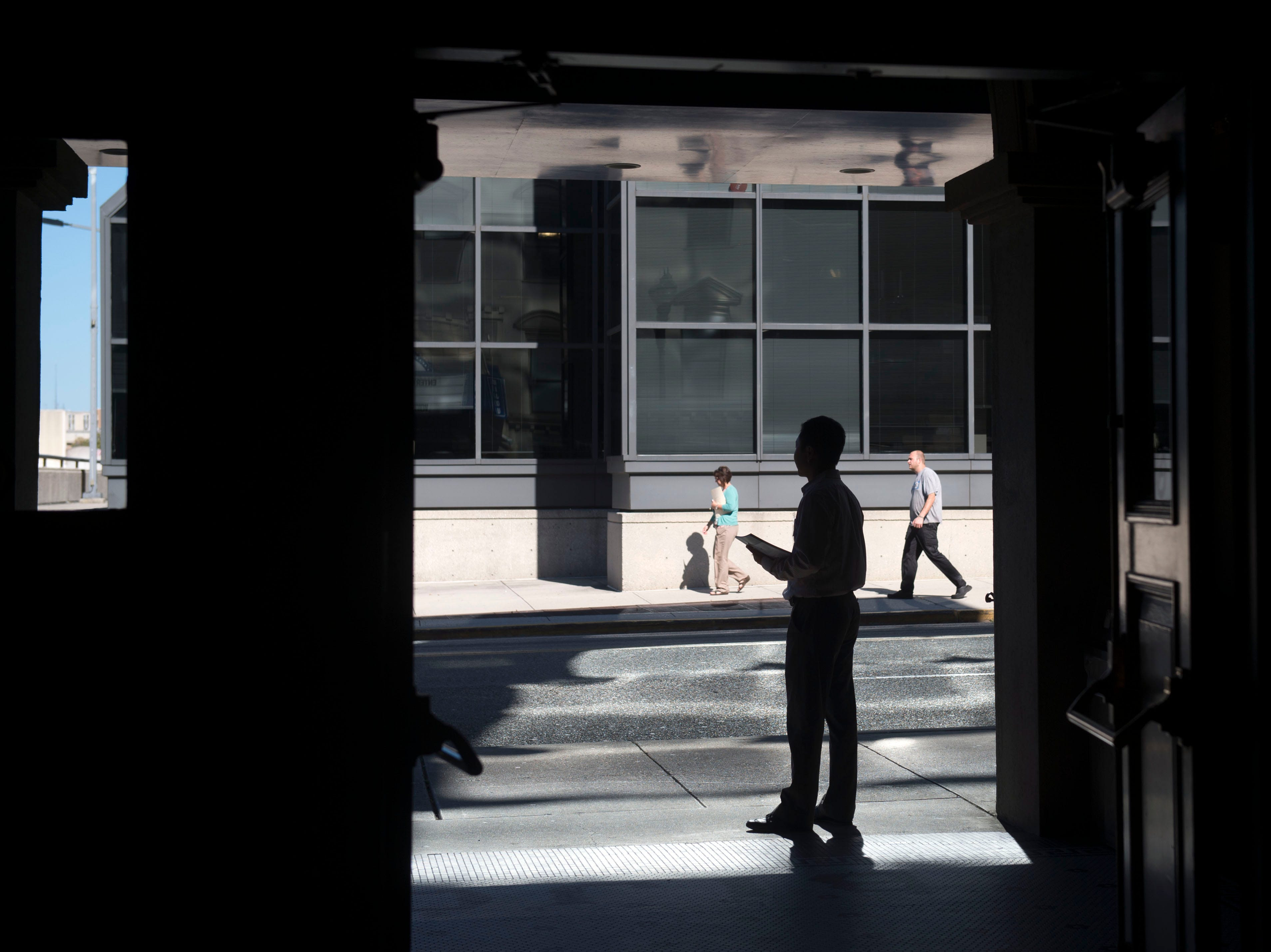 Steve Chin, chief product officer at Survature waits outside to Bijou Theatre on Wednesday, September 24, 2014 to greet guest attending a presentation survey findings collected by Survature from Tennessee Theatre patrons.