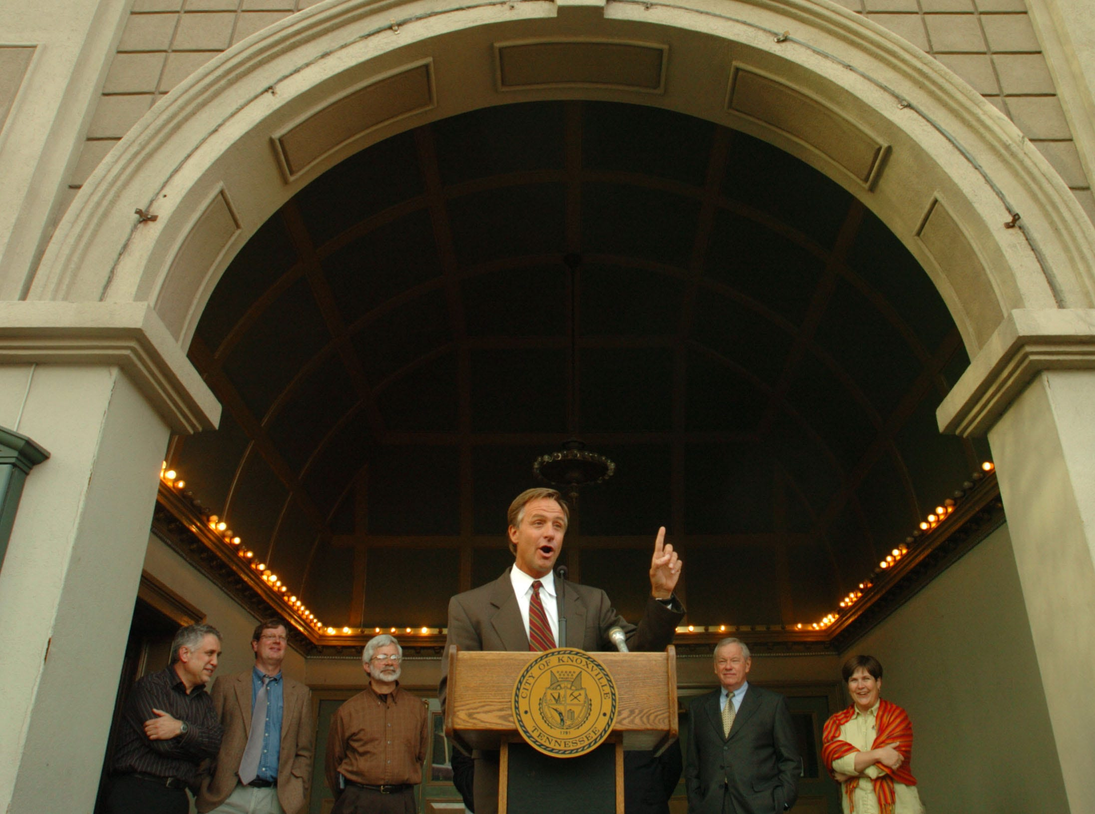Under the arched entrance of the Bjou Theatre, Knoxville Mayor Bill Haslam announces that the Historic Tennessee Theatre Foudation will be taking over management of the Bijou Theatre on 3/31/05.