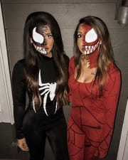 Sierra Jackson and her friend Dafne Sanchez dressed up as Venom and Carnage from Marvel comic series.