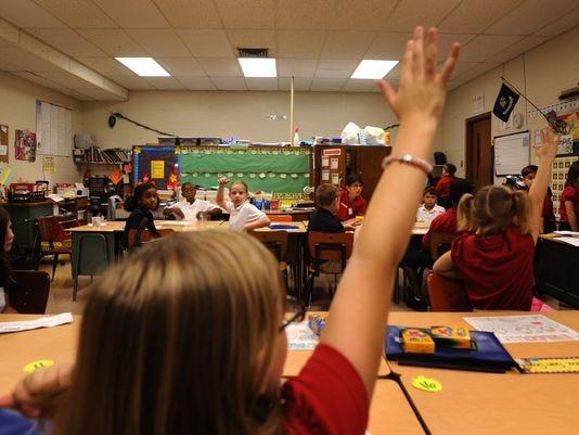 Students participate in class exercises in Lafayette Parish.