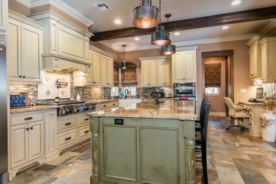 The gourmet kitchen is equipped with designer touches.