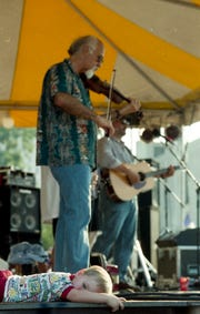 Michael Doucet and BeauSoleil perform during Downtown Alive! Sept. 19, 1997.