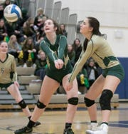 Howell's Sydney Ramonaitis, center, and Kirsten Pasfield go for the volleyball while Amanda Koch (6) watches on Tuesday, Oct. 30, 2018 in the district semifinals against South Lyon.